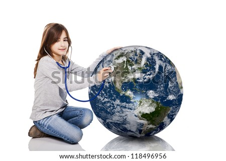 Portrait of a little girl auscultate the health of the planet earth with a stethoscope, isolated on white background - stock photo
