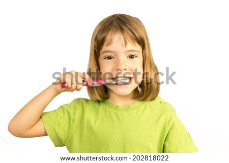 Portrait of a little girl brushing his teeth  - stock photo