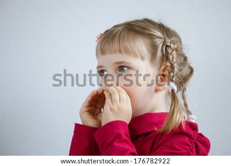 Portrait of a little girl calling somebody, neutral background - stock photo