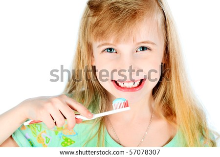 Portrait of a little girl cleaning her teeth with a tooth brush. Isolated over white background.