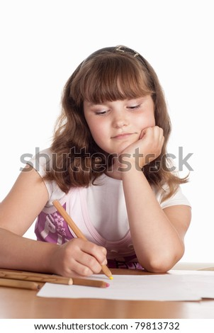 portrait of a little girl drawing at table