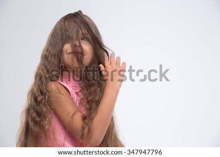 Portrait of a little girl having fun isolated on a white background - stock photo