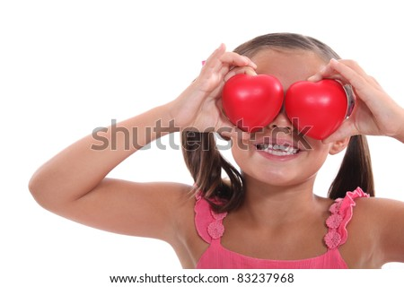 portrait of a little girl holding hearts - stock photo