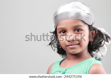 Portrait of a little girl in a happy mood - stock photo