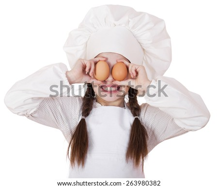 Portrait of a little girl in a white apron holding two chicken eggs, isolated on white background - stock photo