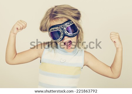 Portrait of a little girl in her arms showing his strength - stock photo
