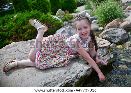 Portrait of a little girl in summer time
