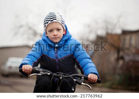 Portrait of a little girl on a bicycle - stock photo