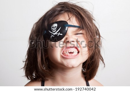 Portrait of a little girl pirate