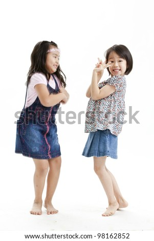 portrait of a little girl playing each other - stock photo