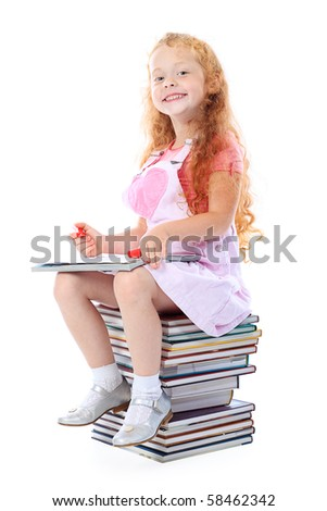 Portrait of a little girl sitting on a stack of books. Isolated over white background. - stock photo