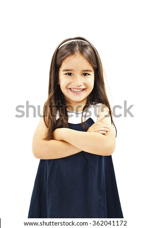 Portrait of a little girl standing with folded hands. Isolated on white background - stock photo