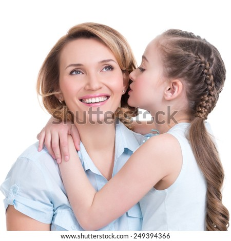 Portrait of a little girl telling her mother a secret studio shot on white background - stock photo
