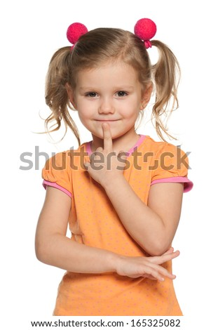 Portrait of a little girl who thinks about a problem - stock photo