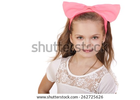 Portrait of a little girl with a red bow on her head, studio on white background  - stock photo