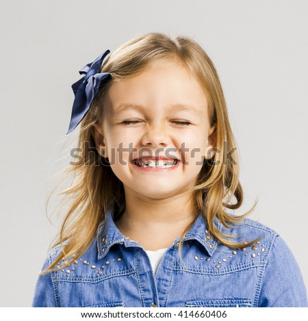 Portrait of a little girl with a smiling expression - stock photo