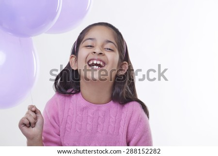 Portrait of a little girl with balloons - stock photo