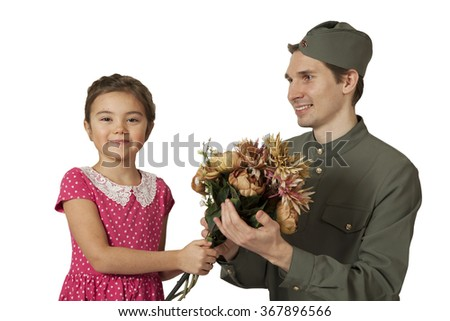 Portrait of a  little girl with bunch of flowers and Soviet soldier in uniform of World War II isolated on white background  - stock photo