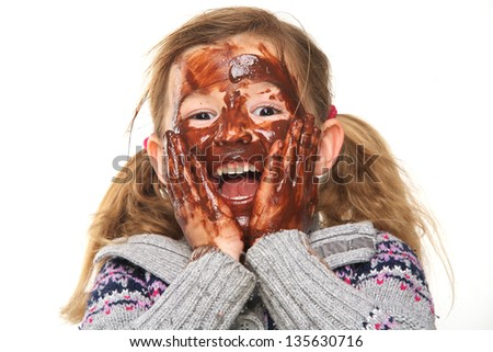 Portrait of a little girl with chocolate covered face - stock photo