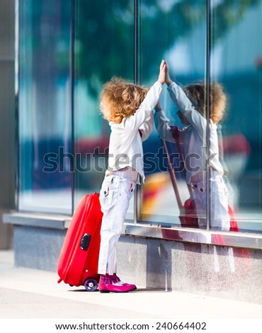 Portrait of a little girl with red bag - stock photo