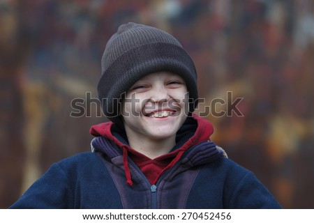 portrait of a little happy homeless boy - stock photo