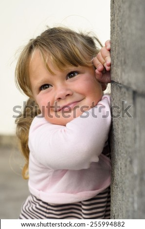 Portrait of a little smiling girl - stock photo