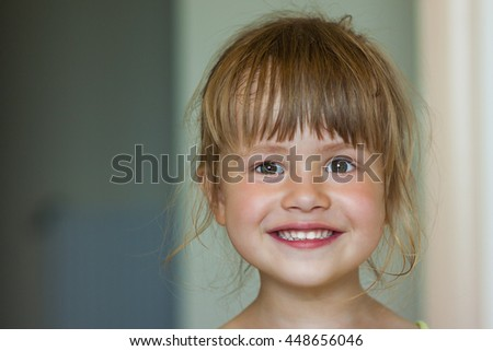 Portrait of a little smiling girl on blurred background - stock photo