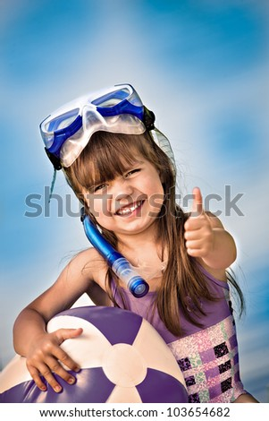portrait of a little snorkeling girl with a ball - stock photo