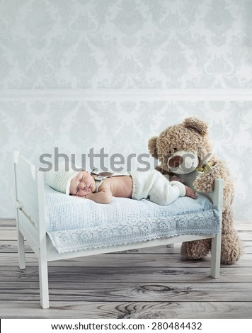 Portrait of a little sweet newborn baby - stock photo