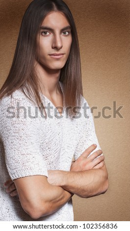 Portrait of a long haired handsome man - stock photo