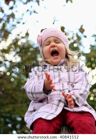 Portrait of a loudly crying child - stock photo