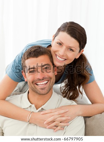 Portrait of a lovely couple at home - stock photo
