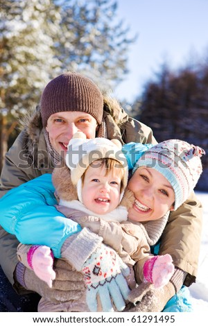 Portrait of a lovely family laughing - stock photo
