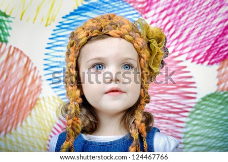 Portrait of a lovely little girl in knitted handmade hat