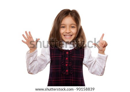 portrait of a lovely little girl, smiling, showing seven items, dressed in school uniform, isolated on white background