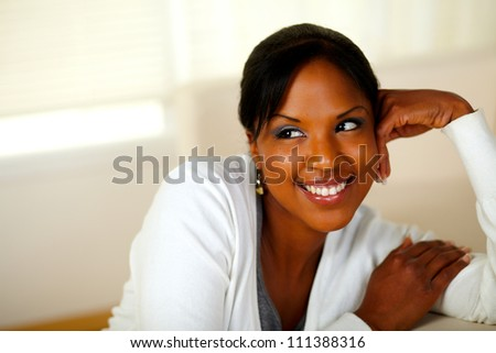 Portrait of a lovely relaxed girl smiling at soft colors composition. With Copyspace