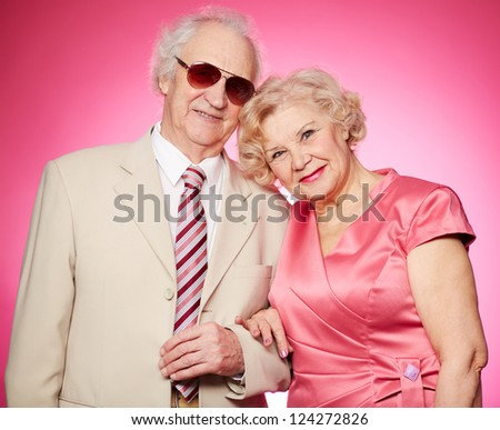 Portrait of a lovely senior couple with positive smiles - stock photo