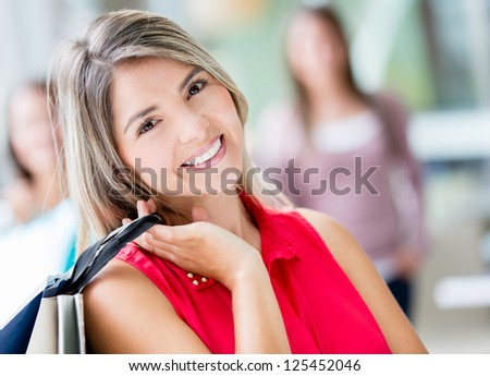 Portrait of a lovely shopping woman holding bags - stock photo