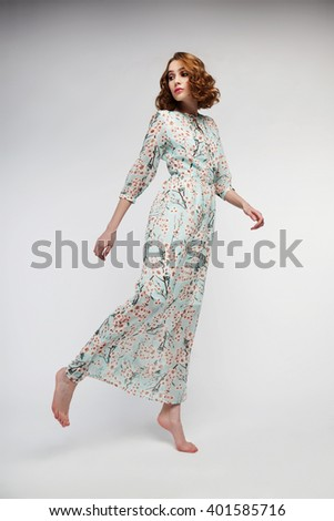 portrait of a lovely woman in casual romantic summer dress. fashion studio photoshoot - stock photo