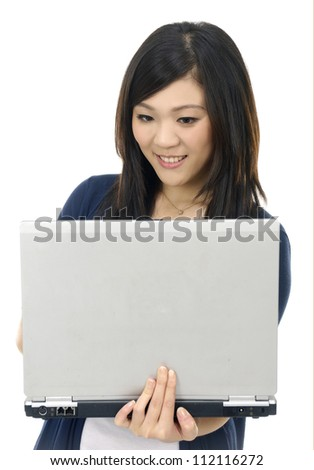 Portrait of a lovely young female using laptop