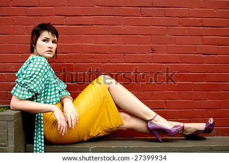 Portrait of a lovely young woman wearing a yellow skirt.