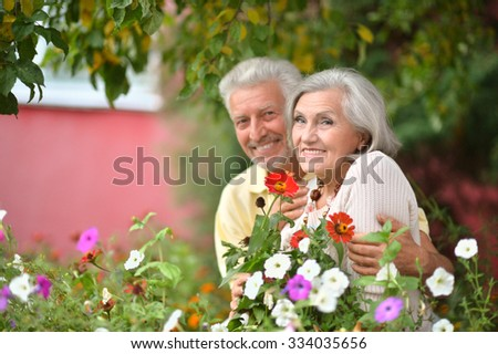 Portrait of a loving mature couple  in summer park