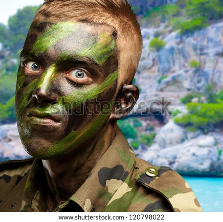 portrait of a mad soldier, outdoor - stock photo