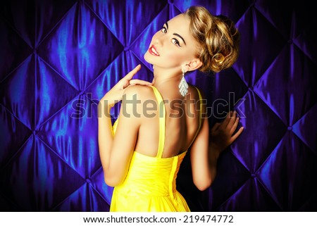 Portrait of a magnificent young woman in evening dress. Fashion shot. - stock photo