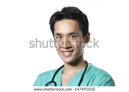 Portrait of a Male Asian doctor wearing Green Scrubs. Isolated on white background. - stock photo