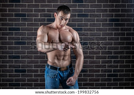 Portrait of a male bodybuilder who points a finger.