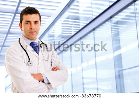 Portrait of a male doctor at a modern hospital - stock photo