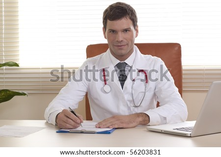 Portrait of a male doctor in his office - stock photo