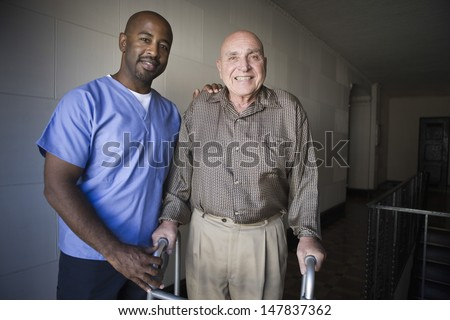 Portrait of a male healthcare worker with elderly man - stock photo
