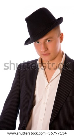 Portrait of a male in a dress shirt with a stylish hat on.